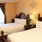 two queen beds with starfish above at Southernmost Point Guesthouse