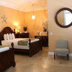 two queen beds and chair at Southernmost Point Guesthouse