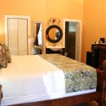 Bed with washing sink and closet at Southernmost Point Guesthouse
