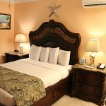 Bed with four fluffy pillows at Southernmost Point Guesthouse